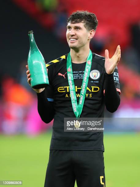 John Stones of Manchester City celebrates after the Carabao Cup Final between Aston Villa and Manchester City at Wembley Stadium on March 01 2020 in...