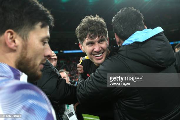 John Stones of Manchester City celebrates following his sides victory during the Carabao Cup Final between Aston Villa and Manchester City at Wembley...