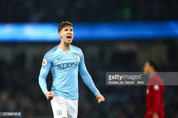 John Stones of Manchester City celebrates his sides 2-1 victory at full time of the Premier League match between Manchester City and Liverpool FC at...