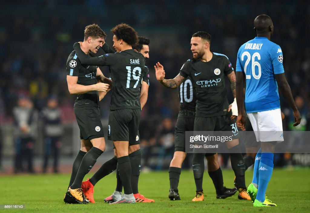 John Stones of Manchester City celebrates scoring his sides second goal with his Manchester City team mates during the UEFA Champions League group F match between SSC Napoli and Manchester City at Stadio San Paolo on November 1, 2017 in Naples, Italy.