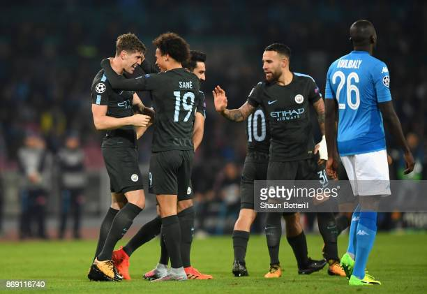 John Stones of Manchester City celebrates scoring his sides second goal with his Manchester City team mates during the UEFA Champions League group F...