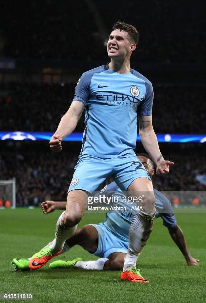 John Stones of Manchester City celebrates scoring his team's fourth goal to make the score 43 during the UEFA Champions League Round of 16 first leg...