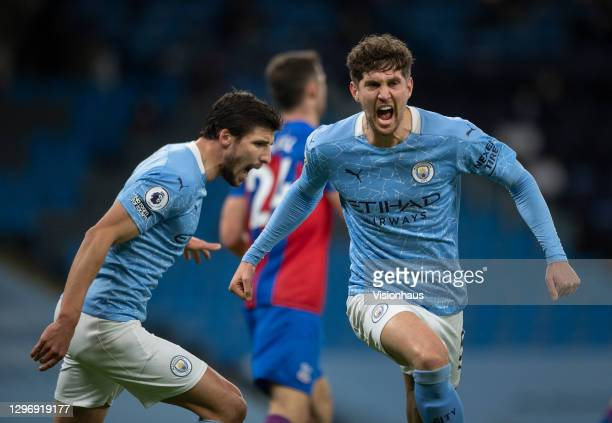 John Stones of Manchester City celebrates scoring the first goal during the Premier League match between Manchester City and Crystal Palace at Etihad...