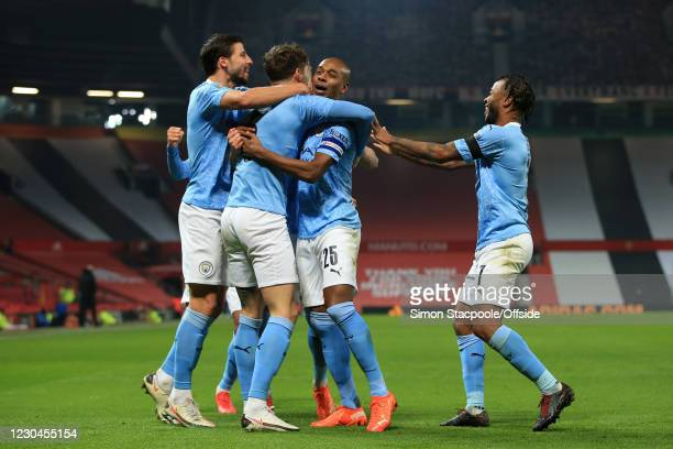 John Stones of Manchester City celebrates scoring the opening goal with Ruben Dias, Fernandinho and Raheem Sterling during the Carabao Cup Semi Final...
