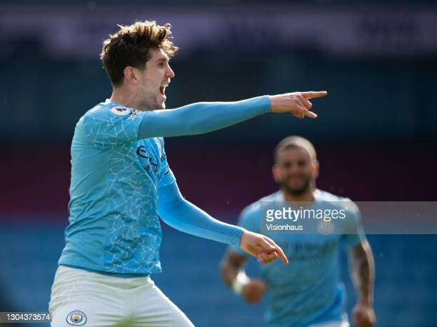John Stones of Manchester City celebrates scoring the second goal during the Premier League match between Manchester City and West Ham United at...