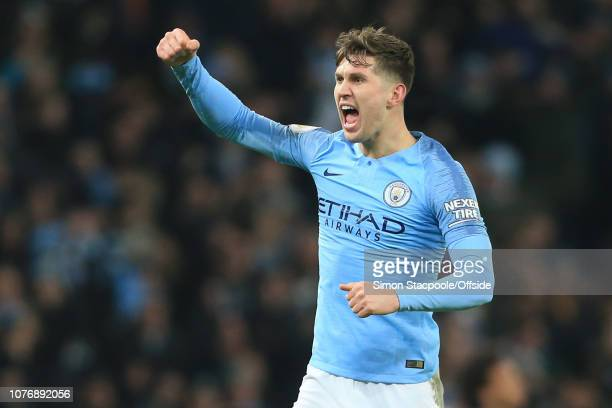 John Stones of Manchester City celebrates their win during the Premier League match between Manchester City and Liverpool FC at the Etihad Stadium on...