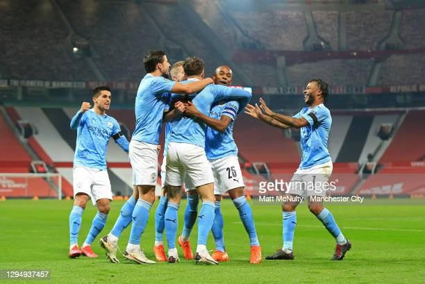 John Stones of Manchester City celebrates with his team after scoring his sides 1st goal during the Carabao Cup Semi Final match between Manchester...