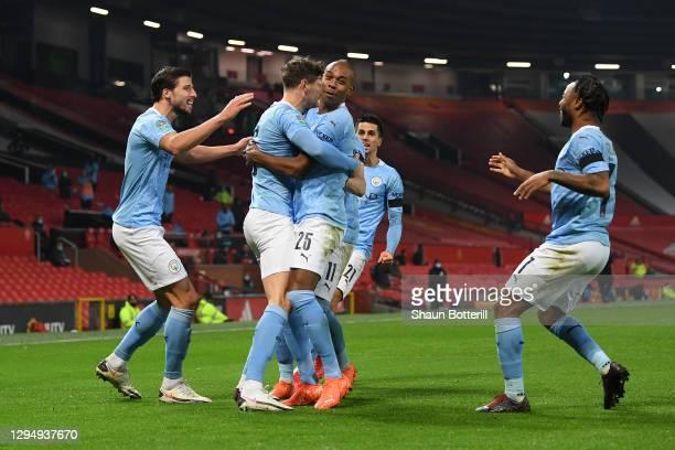 John Stones of Manchester City celebrates with Ruben Dias, Fernandinho, Ferran Torres and Raheem Sterling of Manchester City after scoring his sides...