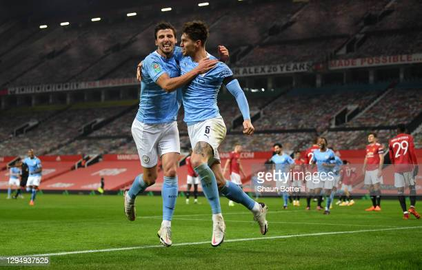 John Stones of Manchester City celebrates with Ruben Dias of Manchester City after scoring his sides 1st goal during the Carabao Cup Semi Final match...