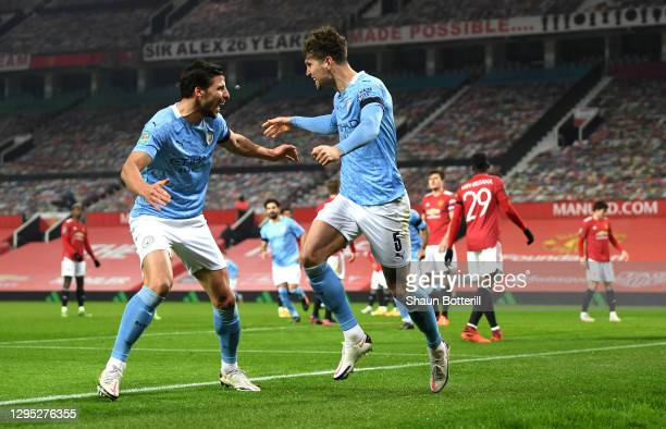 John Stones of Manchester City celebrates with team mate Ruben Dias after scoring his team's first goal during the Carabao Cup Semi Final match...