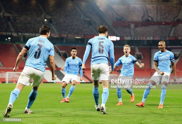 John Stones of Manchester City celebrates with teammates after scoring his teams first goal during the Carabao Cup Semi Final match between...