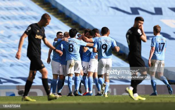 John Stones of Manchester City celebrates with teammates after scoring his team's second goal during the Premier League match between Manchester City...