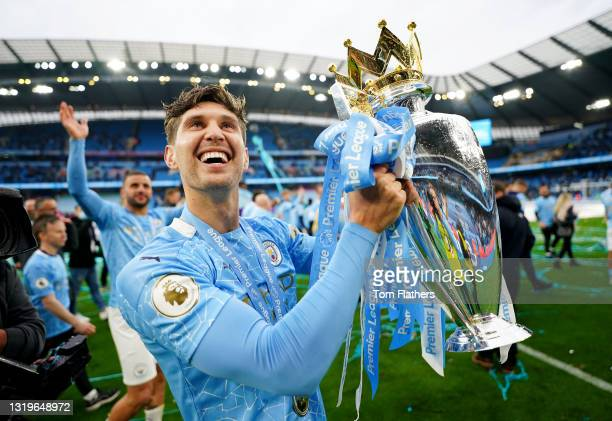 John Stones of Manchester City celebrates with the Premier League Trophy as Manchester City are presented with the Trophy as they win the league...