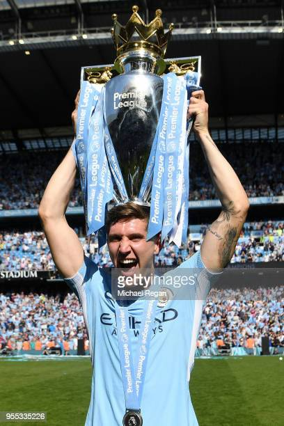 John Stones of Manchester City celebrates with The Premier League Trophy after the Premier League match between Manchester City and Huddersfield Town...