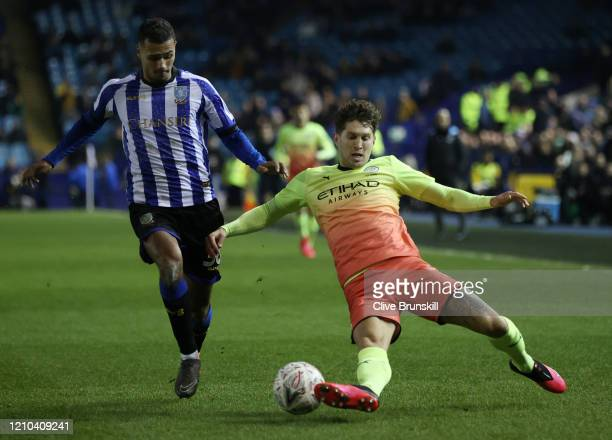John Stones of Manchester City clears the ball while under pressure from Alessio Da Cruz of Sheffield Wednesday during the FA Cup Fifth Round match...