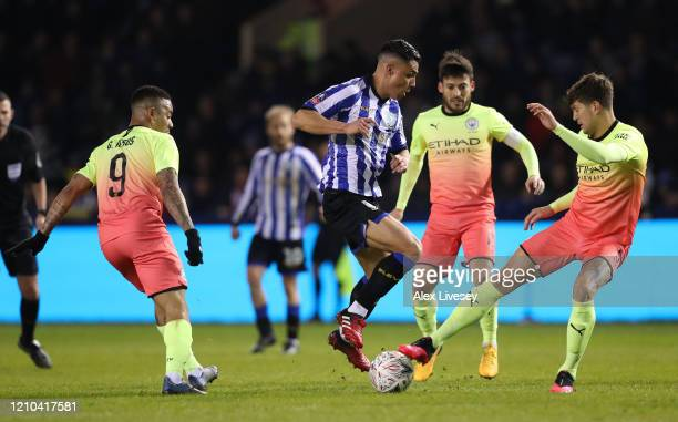 John Stones of Manchester City clears the ball while under pressure from Joey Pelupessy of Sheffield Wednesday during the FA Cup Fifth Round match...