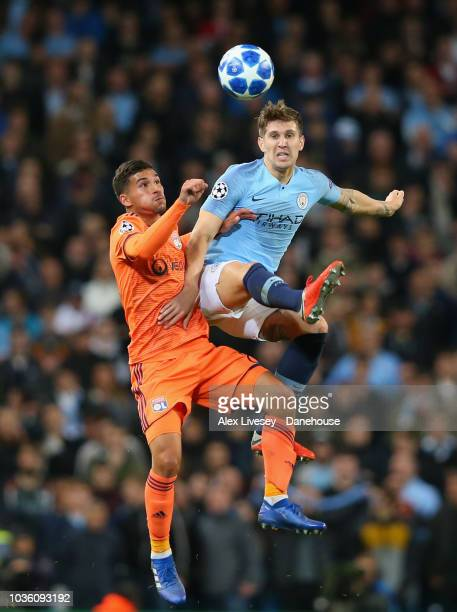 John Stones of Manchester City competes for the ball with Houssem Aouar of Olympique Lyonnais during the Group F match of the UEFA Champions League...