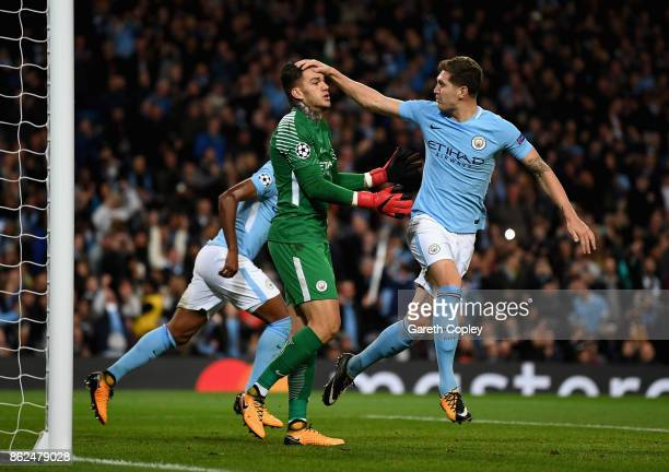 John Stones of Manchester City congratulats Ederson of Manchester City after saving a penalty during the UEFA Champions League group F match between...