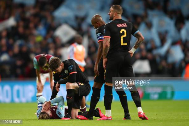 John Stones of Manchester City consoles Jack Grealish of Aston Villa during the Carabao Cup Final between Aston Villa and Manchester City at Wembley...