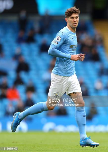 John Stones of Manchester City during the Premier League match between Manchester City and Everton at Etihad Stadium on May 23, 2021 in Manchester,...