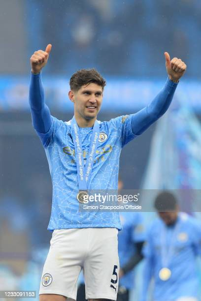 John Stones of Manchester City gives the thumbs-up after the Premier League match between Manchester City and Everton at Etihad Stadium on May 23,...