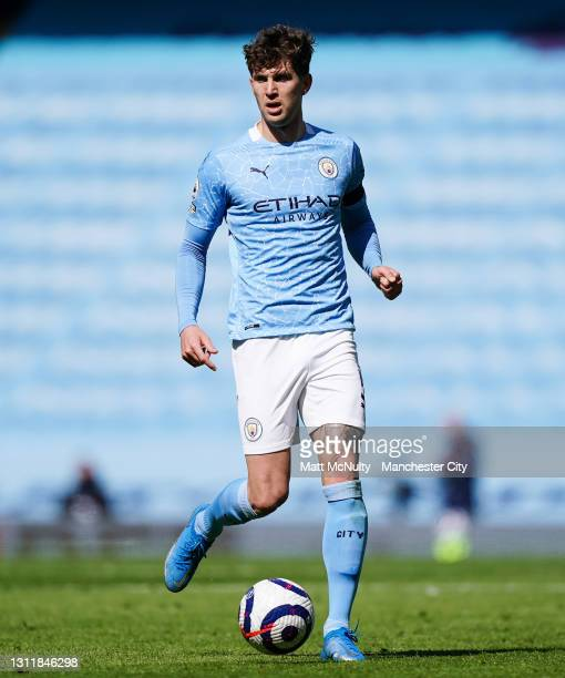 John Stones of Manchester City in action during the Premier League match between Manchester City and Leeds United at Etihad Stadium on April 10, 2021...