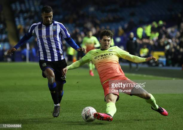 John Stones of Manchester City in action with Alessio Da Cruz of Sheffield Wednesday during the FA Cup Fifth Round match between Sheffield Wednesday...