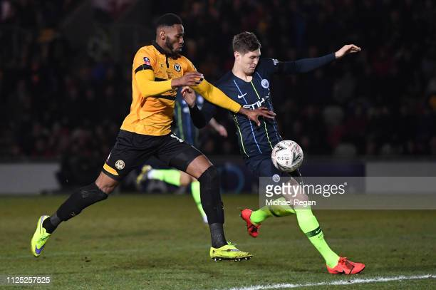 John Stones of Manchester City is challenged by Jamille Matt of Newport County during the FA Cup Fifth Round match between Newport County AFC and...
