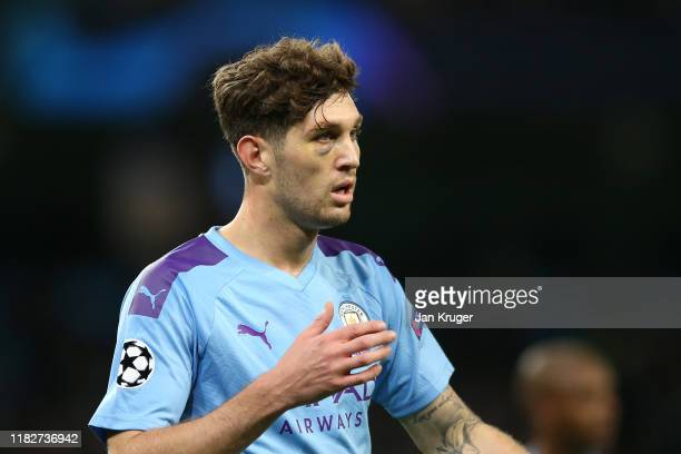 John Stones of Manchester City is seen to have a black eye as he looks on during the UEFA Champions League group C match between Manchester City and...