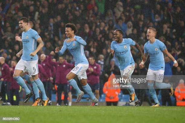 John Stones of Manchester City Leroy Sane of Manchester City Raheem Sterling of Manchester City and Alexander Zinchenko of Manchester City celebrate...