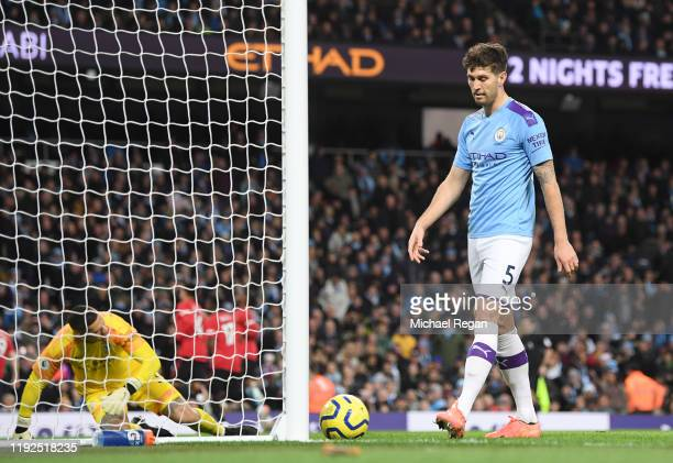 John Stones of Manchester City looks dejected following Manchester United's second goal during the Premier League match between Manchester City and...