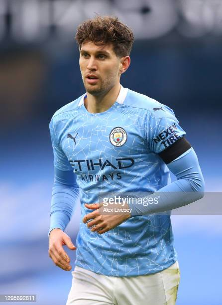 John Stones of Manchester City looks on during the FA Cup Third Round match between Manchester City and Birmingham City on January 10, 2021 in...