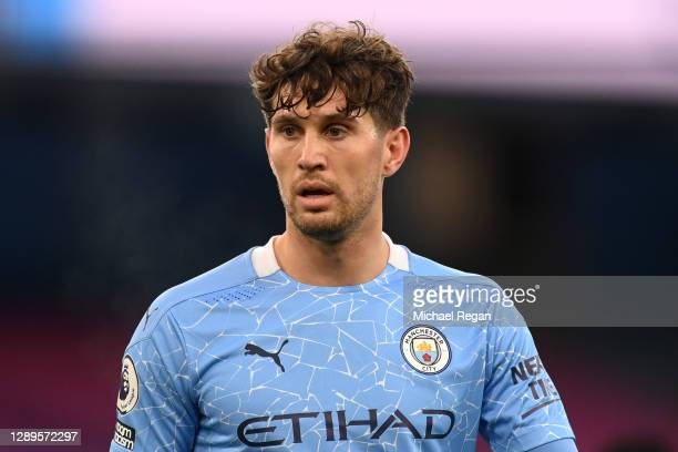 John Stones of Manchester City looks on during the Premier League match between Manchester City and Fulham at Etihad Stadium on December 05, 2020 in...