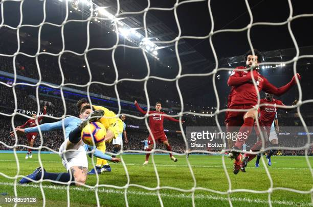 John Stones of Manchester City makes a goal line clearance during the Premier League match between Manchester City and Liverpool FC at the Etihad...