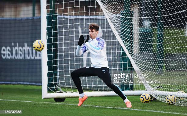 John Stones of Manchester City makes a save during the training session at Manchester City Football Academy on November 21 2019 in Manchester England