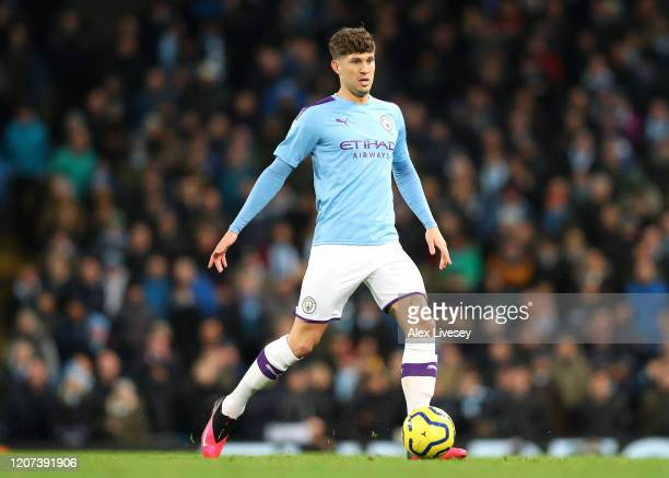 John Stones of Manchester City passes the ball during the Premier League match between Manchester City and West Ham United at Etihad Stadium on...