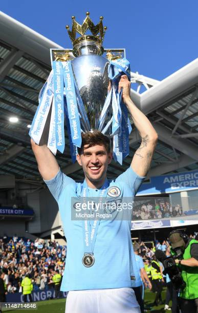 John Stones of Manchester City poses with the Premier League trophy during the Premier League match between Brighton Hove Albion and Manchester City...