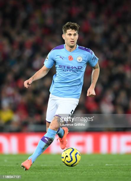 John Stones of Manchester City runs with the ball during the Premier League match between Liverpool FC and Manchester City at Anfield on November 10,...