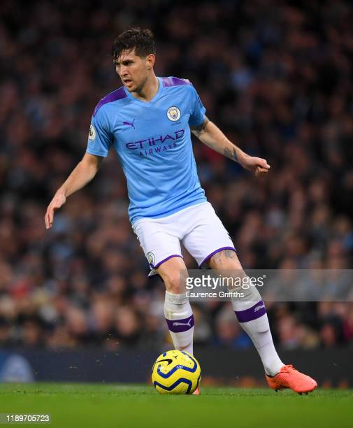 John Stones of Manchester City runs with the ball during the Premier League match between Manchester City and Chelsea FC at Etihad Stadium on...
