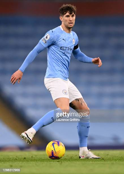 John Stones of Manchester City runs with the ball during the Premier League match between Manchester City and Burnley at Etihad Stadium on November...