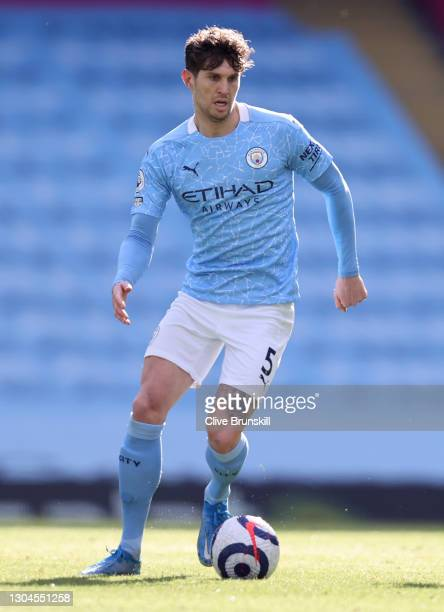 John Stones of Manchester City runs with the ball during the Premier League match between Manchester City and West Ham United at Etihad Stadium on...