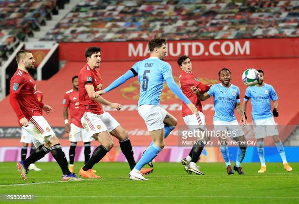 John Stones of Manchester City scores his teams first goal during the Carabao Cup Semi Final match between Manchester United and Manchester City at...