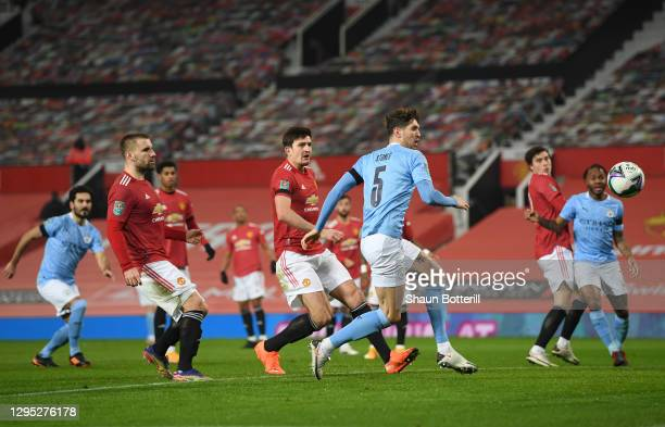 John Stones of Manchester City scores the first goal during the Carabao Cup Semi Final match between Manchester United and Manchester City at Old...