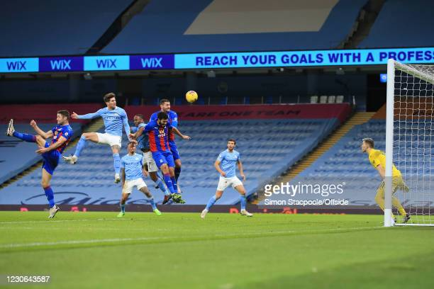 John Stones of Manchester City scores the opening goal during the Premier League match between Manchester City and Crystal Palace at the Etihad...