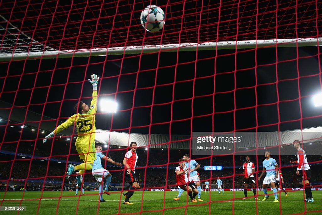 John Stones of Manchester City (5) scores their fourth goal past goalkeeper Brad Jones of Feyenoord during the UEFA Champions League group F match between Feyenoord and Manchester City at Feijenoord Stadion on September 13, 2017 in Rotterdam, Netherlands.