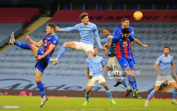 John Stones of Manchester City scores their sides first goal during the Premier League match between Manchester City and Crystal Palace at Etihad...