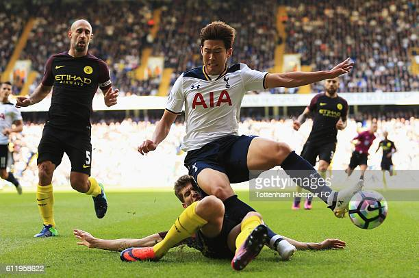 John Stones of Manchester City tackles HeungMin Son of Tottenham Hotspur during the Premier League match between Tottenham Hotspur and Manchester...