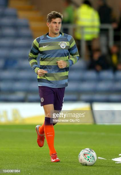 John Stones of Manchester City warms up prior to the Carabao Cup Third Round match between Oxford United and Manchester City at Kassam Stadium on...