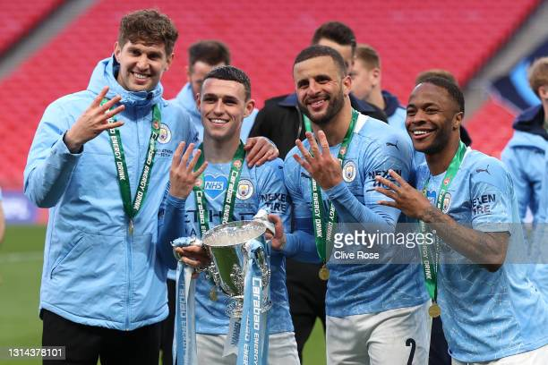 John Stones, Phil Foden, Kyle Walker and Raheem Sterling of Manchester City celebrates with the trophy after winning the Carabao Cup after the...