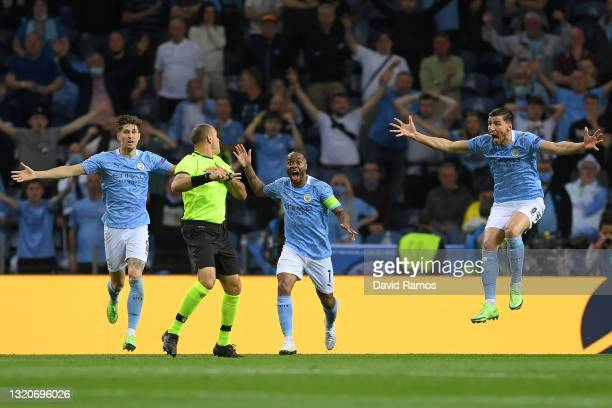 John Stones, Raheem Sterling and Ruben Dias of Manchester City confront match referee Antonio Mateu Lahoz during the UEFA Champions League Final...